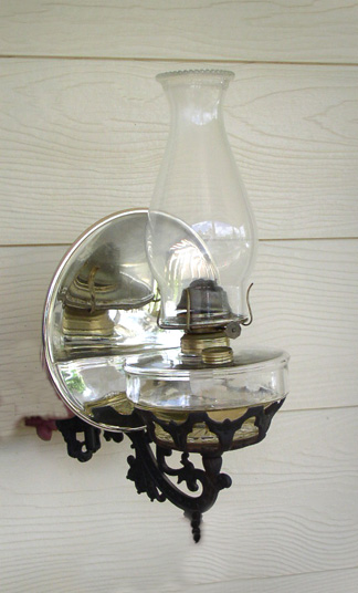 G116 Oil Lamp wall mount with iron base & reflector | Wall Auctioneers